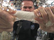 In this series of images, Commander<br /> Chris Hadfield demonstrates what happens<br /> when a water-saturated washcloth is wrung<br /> out in microgravity.<br /> Credit: NASA TV